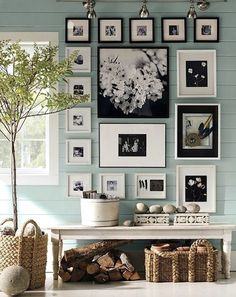 I like the black and white against the robins egg blue wall! Just beautiful.