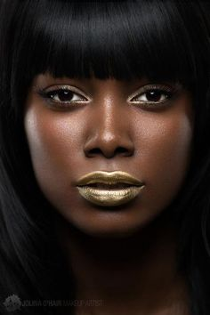 Forget the gold lips - look at her skin, crazy perfect...