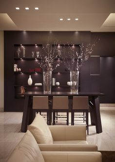 the dark wall/floating shelves; the tall vases with cherry blossom-esque twigs; the sky lights