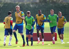 Aaron Ramsey Photos Photos - (L-R) Per Mertesacker, Aaron Ramsey, Danny Welbeck, Mesut Ozil and Lukas Podolski warm up during a Arsenal Training Session ahead of their Champions League fixture against Borussia Dortmund on September 15, 2014 in St Albans, England. - Arsenal Training Session