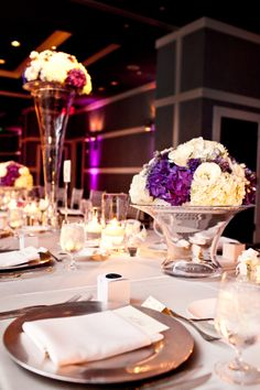 Purple hydrangeas are the perfect punch to this silver and white tablescape.