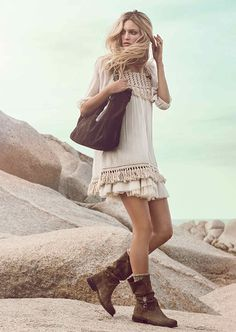 Beautiful layered smock dress with fringed hem. Great winter boots too. Boho babe.
