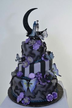Cool black and purple topsy turvy cake