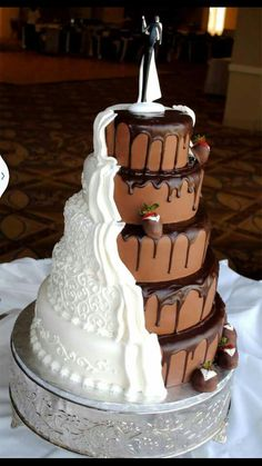 i think this would be mine and Chris's perfect wedding cake-me traditional and chocolate for chris!!