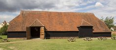 The outside of the Grange barn with picnic benches infront
