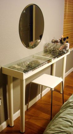 Makeup organizing, vanity table. Use a glass-topped shelf from ikea as a tabletop; add legs; add plastic trays or boxes underneath the glass.