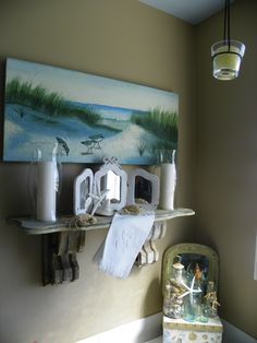 Master bath...shelf was made from vintage brackets & I bought it in Southport. I love my sand color walls.