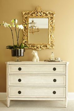 """Great chest.  Love the flowers """"potted"""" in a trifle bowl.  ML Interior Design"""