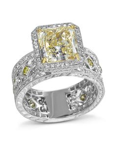 Platinum and 18 karat yellow gold ring set with a carat radiant-cut fancy yellow diamond center clarity) surrounded by 168 round brilliant cut diamonds CTW, F-G color, VS-clarity) and 13 round fancy yellow diamonds CTW, VS-clarity). Yellow Diamond Rings, Yellow Diamonds, Radiant Cut Diamond, Diamond Cuts, Gia Certified Diamonds, Hand Engraving, Diamond Engagement Rings, Diamond Jewelry, Clarity