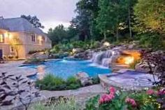 """Now this truly would be paradise! The waterfalls, rocks, lighting and foliage are just a few of what makes this my dream pool, I would have a stone pool deck with intimate seating areas surrounded by lush tropical foliage into our fabulous """"beach entry"""" pool with adjoining hot tub, with swim though doublesided rock waterfalls and slides with built in mini bar and stone stools for """"in water"""" relaxation, soft lighting, tiki torches provide ambiance.."""