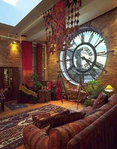 Brick wall, outthrough visible clock, rustic colors on walls n floor n furnitures ..a complete industrial outlook