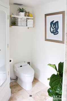 """You won't believe the transformation in this bathroom makeover with bold modern wallpaper! It went from """"blah"""" to stylish and fresh with a few easy DIY projects. OK, I have to apologize for something… Green Bathrooms Designs, Modern Bathrooms Interior, Contemporary Bathroom Designs, Modern Master Bathroom, Guest Bathrooms, Simple Bathroom, Bathroom Interior Design, Minimalist Bathroom, Rustic Bathroom Shelves"""