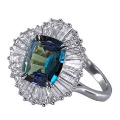"Mark Henry alexandrite ballerina ring: Platinum ring showcases a 2.63 ct. cushion-cut alexandrite set in a vintage ""ballerina"" design, featuring 2.84 cts. t.w. tapered baguette diamonds around the center stone."