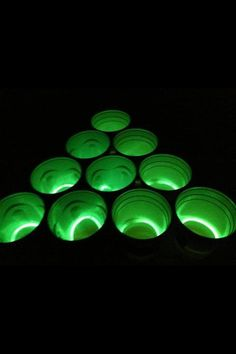 Glow bracelets in beer pong cups! Brilliant, safe inexpensive. Party guests happy hour goers will love it - way to dress up your drinking games. CHEERS, mates.