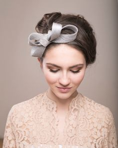 Bridal silver bow headpiece, wedding millinery fascinator by BeChicAccessories on Etsy https://www.etsy.com/listing/228116955/bridal-silver-bow-headpiece-wedding