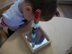 Adding the element of mirrors to block play is a great way to play with symmetry and light.  The blocks that connect are also great for building towers with.
