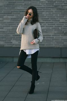 Beatrice Gutu is wearing a grey sweater from Zara, white shirt from Forever 21, black jeans from Asos and shoes from Missguided
