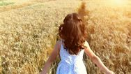 Pond5 Royalty Free Stock Footage: Little girl running cross the wheat field