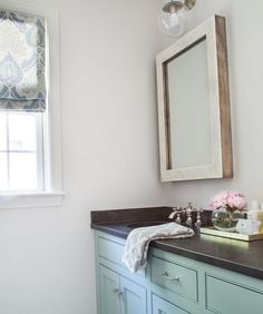 "The wall paint color is ""Benjamin Moore Silver Satin"". It looks perfect with the robin's egg color used on the cabinets. Wall Paint Colors, Bathroom Decor Pictures, Green Flooring, Coastal Interiors, Master Bathroom Decor, Diy Bathroom Decor, Small Bathroom Decor, Luxury Interior Design, Painting Bathroom"