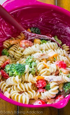 This simple pasta salad has the works! Bacon, crisp peppers, broccoli, feta cheese, grilled chicken, and tomatoes covered in a creamy buttermilk greek yogurt dressing!!