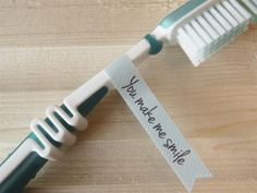 "Inspiration: surprise your loved-one with a sweet flag label attached to his or her toothbrush. DIY this with washi tape or paper and write ""you make me smile"" or your own message. This label is from Dreamkey Design. It's part of a set of printables for €0,95 (PDF file or sticker sheet)."