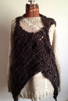This stunning vest can be worn many different ways and will make any outfit be more fun and creative! Simple to knit, loads of style~ Knitted on big needles (sizes 13 and 19) and with chunky fluffy ya
