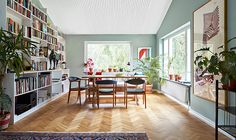 The heart of the house. Mild and homey with wooden floors and walls painted in pale blue green. The paint used is Alcro Fjärilslarv. Photo: Klas Sjöberg.