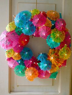 Get creative with your Christmas in July decor. Try this drink umbrella wreath to welcome guests.