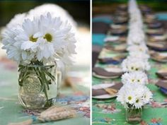 Daisy's in jars... you could recycle jam jars ect and tie a ribbon around them.
