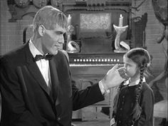 Photo of Wednesday and Lurch for fans of Addams Family. Wednesday Addams and Lurch.