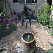 Gravel patio with fountain