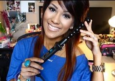 The Gorgeous Ashley Sander with her Pearl Curling Wand.