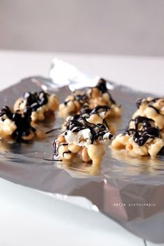 Popcorn-salted nuts with caramel sauce.