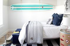Beach-inspired boy's bedroom with surfboard