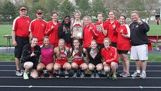 The Bulldog Girls Track and Field Team and coaches were all smiles after they won the B-2 District Championship following three consecutive runner-up finishes.