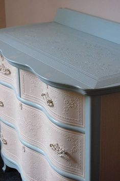 Pretty dresser with embossed paper