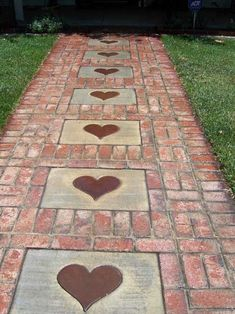 Create a brick walkway and then accent it with concrete stepping stones printed with heart shapes.