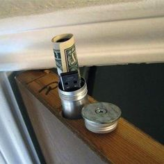 If you have a hollow-core door, it's easy to use that inner space to hide small valuables—like jewelry or a memory stick—that you won't need to access often. Buy metal storage tubes and attach a washer that's bigger than the diameter of the tube to the lid. Make a hole the size of the tube in the top of the door, drop the tube in and you've just opened the door to secret storage!