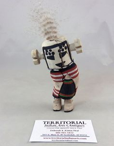 "Traditional Hopi Kachina tihu carved from dried cottonwood root and painted, stands or hangs 5"" tall plus the feather."