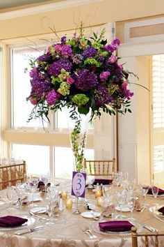 purple and green tall wedding centerpiece / http://www.himisspuff.com/purple-wedding-ideas/13/