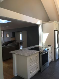 Wall was removed between kitchen and living room to look out windows at lake Kitchen Island With Cooktop, Kitchen Stove, Kitchen Redo, Kitchen Layout, New Kitchen, Kitchen Design, Stove In Island, Kitchen Pass, Kitchen Ideas