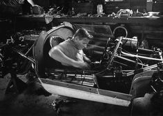Bruce McLaren, at work in the 'shed' on one of his early McLaren-Oldsmobile Elva MkI's Photo by Flip Schulke