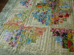 QUILTING BOARD ~ BARNBUM ~Okay, here's what the 50 floral log cabin blocks turned into. 7-12-11