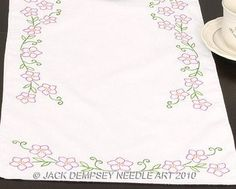 """Floral Spray Table Runner - Embroidery Kit by Jack Dempsey Needle Art. $5.93. Each package contains one scarf of cotton/poly broadcloth, with a perle edged finish. Approximate size: scarf - 14-1/2"""" x 41-1/2"""". Additional materials needed to complete: Hoop, needle, and floss. Floss requirements included. Floss is NOT included with this kit."""