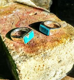 Two turquoise and sterling silver ring on the finishing block.