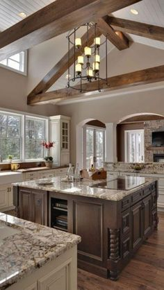Antique White Kitchen Cabinets | Granite pulls together the Traditional Wooden beam and paint color ...