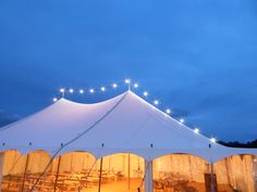Elegant marquee hire for weddings, parties and corporate events. Flying Festoon lighting atop our scooped marquee