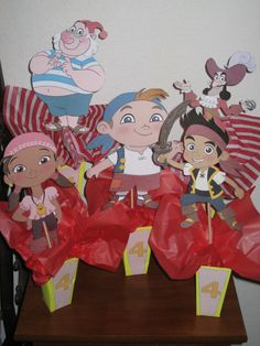 Jake and Neverland Pirates centerpieces. I  made the clipart as large as possible on 8.5x11 then cut them out on card stock. Follow the link for the box template. I used dowels on the back of each one and tissue paper and rocks for weight in the boxes.