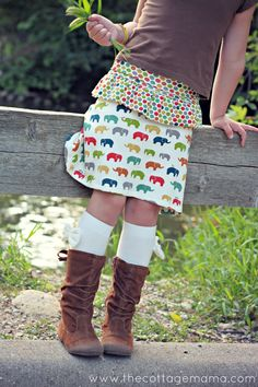 Free skirt pattern tutorial in size 12 month - 12 years over at The Cottage Mama. It's the perfect, casual look for your little girl. www.thecottagemama.com