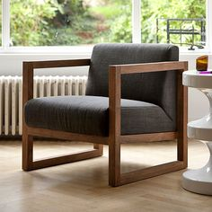 Teak Lounge Chair Square Root from Lekker Home.